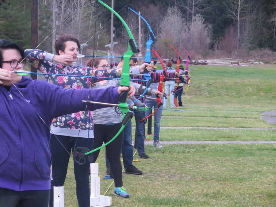Members of the Archer Club line up and shoot simultaneously.