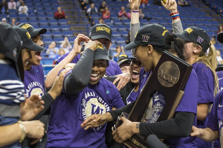 Washington piles on to Chantel Osahor as it is announced she is the tournament's Most Valuable Player.  Washington and Stanford played in the Lexington Regional Final Sunday, March 27, 2016.  (Dean Rutz / The Seattle Times)