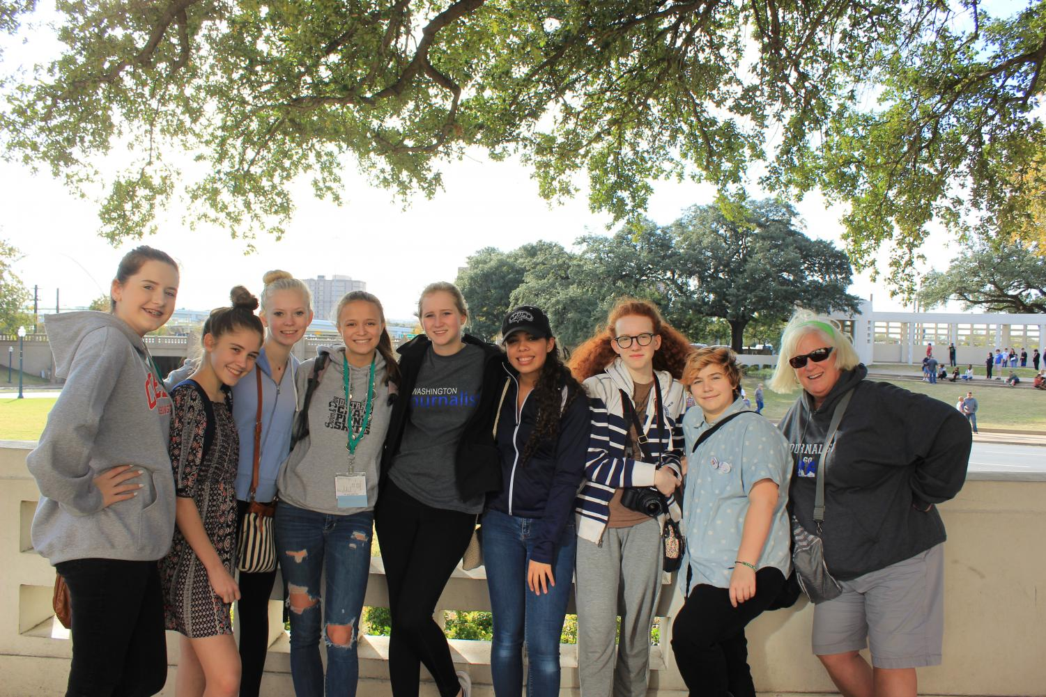 2017-18 yearbook and newspaper staff enjoy sightseeing in Dallas after competing in the fall annual JEA and NSPA journalism competition. Names listed from left to right: Ashleigh Johnson, Katherine Wallace, Claire Willis, Hadley Olson, Chelsea Bagwell, Ciara Greene, Alex Blashwood, Kai Cole, and Mrs. Robin Smith. Image taken by yearbook and newspaper advisor, Mr. Roland Smith.