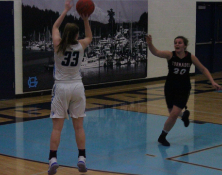 Maddie Wilett shoots a three-pointer against Yelm. Photo provided by Claire Willis.