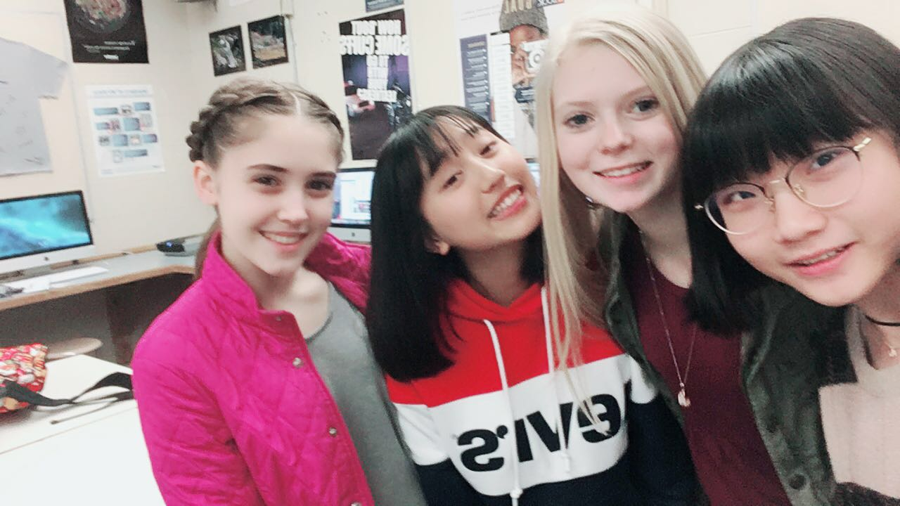 Katherine Wallace and Claire Willis take a selfie with their assigned Chinese exchange students, Joy and Chachi. Photo taken by Claire Willis.