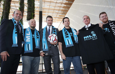 David Beckham accompanied by team officials and Commissioner Don Garber after the big reveal. Image from http://wvhooligan.com/2014/06/11/beckham-group-on-to-plan-c-in-miami/.
