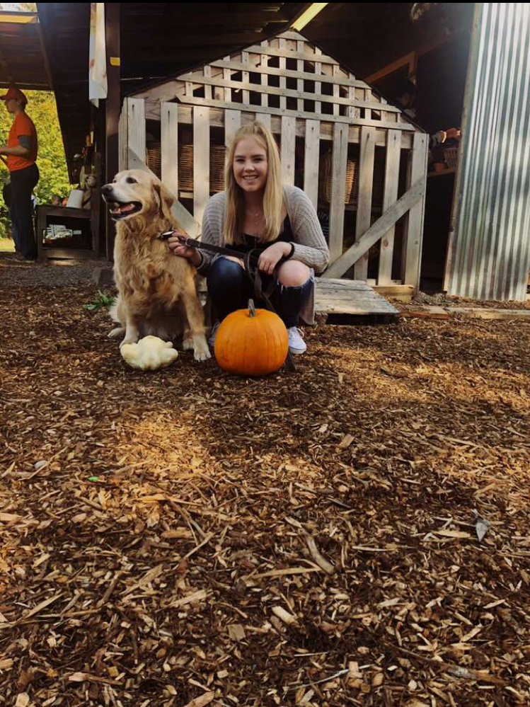 Hannah McCrossin with her dog and a pumpkin of her own. Photo taken by Hannah McCrossin.