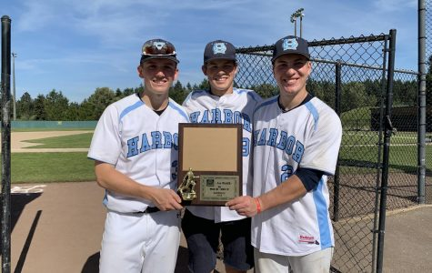Owen Wild (11), Luke Deschenes (11), and Cage Hardy (12) after winning the District Tournament. Photo Credit Anya Wild.