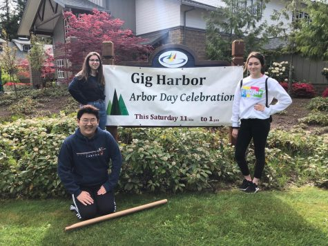 Key club at Volunteering at Arbor Day Celebration. Maddie Simmons (11), Katherine Jones (11), and Nicholas Shin (10). Photo Credit Tyra Stout (11).